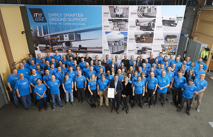 Group photo of all employees and guests